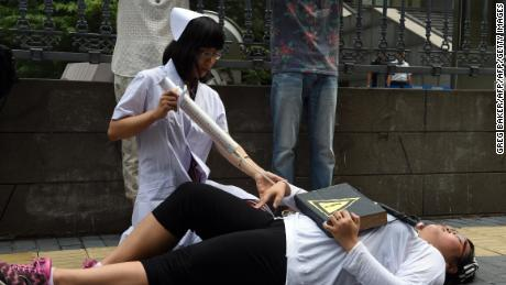 Activists stage a protest against so-called gay conversion therapies outside a Beijing court in July 2014.