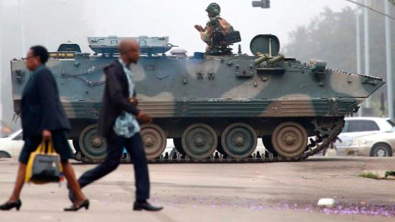 "An armored vehicle patrols a street in Harare on Wednesday, November 15. In a dramatic televised statement, an army spokesman denied that a military takeover was underway, but the situation bore all the hallmarks of one. The military said Mugabe and his family were ""safe."""