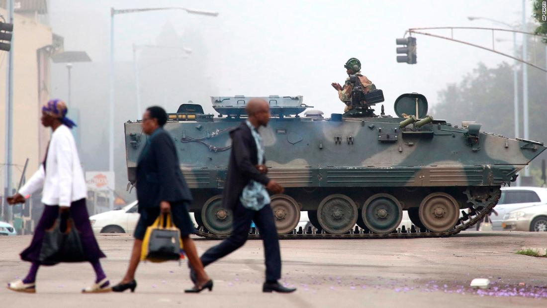 "An armored vehicle patrols a street in Harare on Wednesday, November 15. In a dramatic televised statement, an <a href=""http://www.cnn.com/2017/11/14/africa/zimbabwe-military-chief-treasonable-conduct/index.html"">army spokesman denied that a military takeover was underway,</a> but the situation bore all the hallmarks of one. The military said Mugabe and his family were ""safe."""