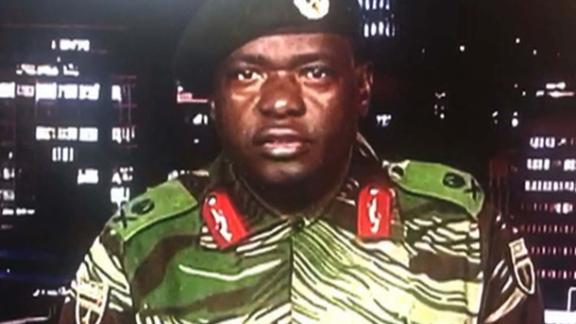 "In a screen grab of a TV broadcast on the Zimbabwe Broadcasting Corp., Maj. Gen. Sibusiso Moyo reads a statement saying the military was conducting an operation to target ""criminals"" close to the President who were causing ""social and economic suffering."" He denied a coup was underway."