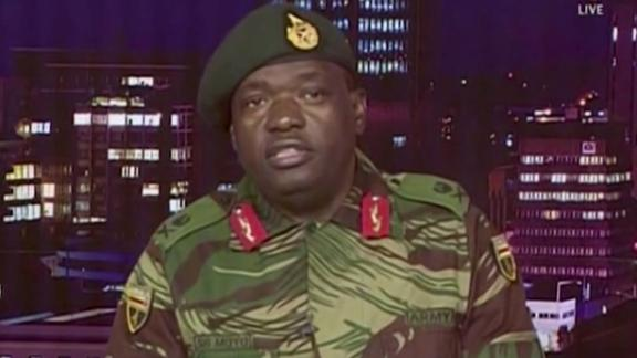 Maj. Gen. S.B. Moyo reads a statement during a TV broadcast on the Zimbabwe Broadcasting Corp.