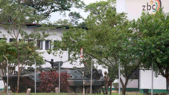 An armored military vehicle is seen outside the building of the state-run Zimbabwe Broadcasting Corp. on November 15.