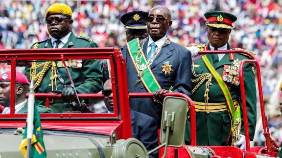 Mugabe reviews the guard of honor during Zimbabwe