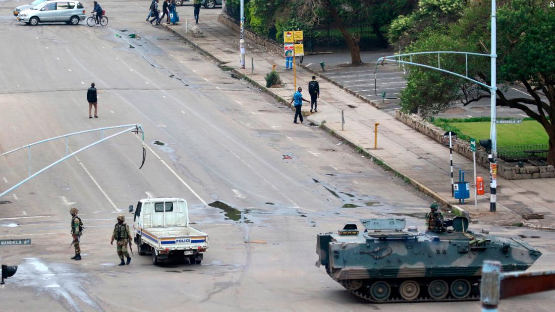 Soldiers patrol a street in Harare on November 15.