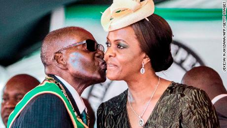 Former President Robert Mugabe kisses his wife and former first lady Grace Mugabe during the country's 37th Independence Day celebrations in 2017.