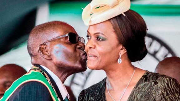 Mugabe kisses his wife during Independence Day celebrations in April 2017. In early November, the sacking of Mugabe