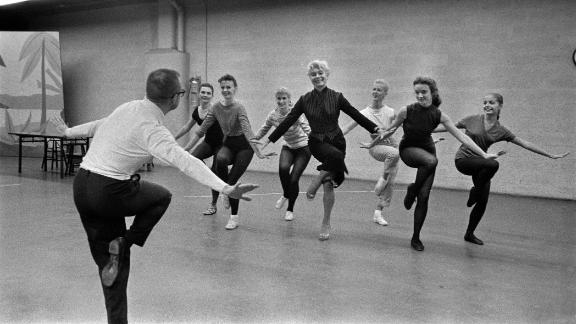 Channing, center, rehearses for a musical on CBS with choreographer Eugene Loring in 1957.