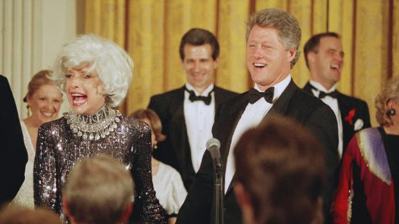 President Bill Clinton greets the Broadway star after her performance at a White House dinner in February 1993. The event was the first official dinner hosted by Clinton at the White House.