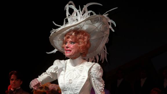 "Channing thanks the audience in a curtain call after a performance during a revival of ""Hello, Dolly!"" in New York in January 1996. She reprised the role in multiple productions over the decades. Here, she was celebrating her 4,500 performance of the legendary show."