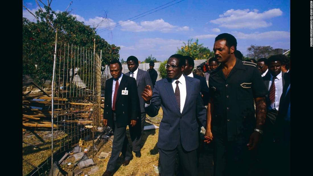 Mugabe walks hand in hand with American civil rights activist Jesse Jackson during the Summit of Non-Aligned Countries, which Harare hosted in 1986.