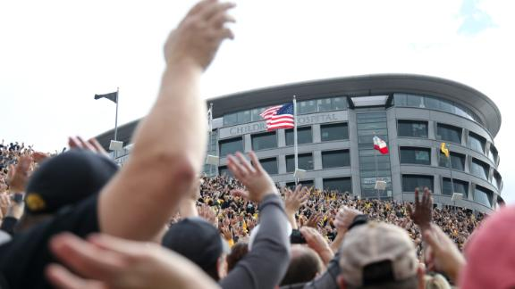 Fans at Iowa's Kinnick Stadium wave to the children watching from the nearby University of Iowa Stead Family Children's Hospital.