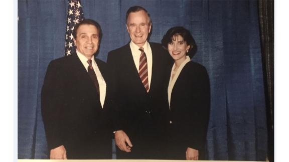 """This image provided to CNN by the """"Michigan woman"""" shows former President George H.W. Bush with the woman at a 1992 fundraiser."""