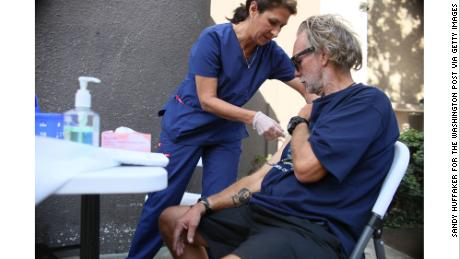 A San Diego nurse gives a Hepatitis A vaccine to a Homeless person in downtown San Diego.