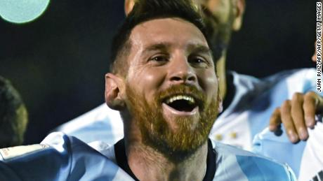 Argentina's Lionel Messi celebrates after defeating Ecuador and qualifying to the 2018 World Cup football tournament, in Quito, on October 10, 2017. / AFP PHOTO / Juan Ruiz        (Photo credit should read JUAN RUIZ/AFP/Getty Images)
