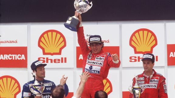 An exhausted Senna could hardly live the trophy after winning the 1991 Brazilian Grand Prix