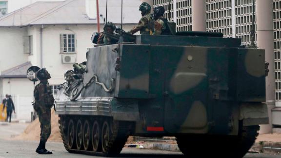 A military vehicle is seen on a street in Harare, Zimbabwe, Thursday, Nov. 16, 2017. People across the country are starting another day of uncertainty amid quiet talks to resolve the country's political turmoil and the likely end of President Robert Mugabe's decades-long rule. Mugabe has been in military custody and there is no sign of the recently fired deputy Emmerson Mnangagwa, who fled the country last week. (AP Photo)