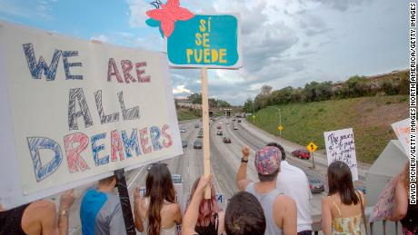 LOS ANGELES, CA - SEPTEMBER 10: People hold signs over the 110 freeway as thousands of immigrants and supporters join the Defend DACA March to oppose the President Trump order to end DACA on September 10, 2017 in Los Angeles, California. The Obama-era Deferred Action for Childhood Arrivals program provides undocumented people who arrived to the US as children temporary legal immigration status for protection from deportation to a country many have not known, and a work permit for a renewable two-year period. The order exposes about 800,000 so-called ÒdreamersÓ who signed up for DACA to deportation. About a quarter of them live in California. Congress has the option to replace the policy with legislation before DACA expires on March 5, 2018.  (Photo by David McNew/Getty Images)