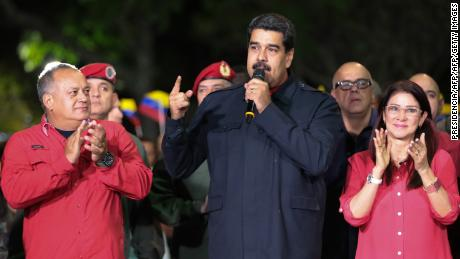 "Venezuelan President Nicolas Maduro (R) speaks beside First lady Cilia Flores (R) and  Diosdado Cabello (L), a member of the Constituent Assembly, in Caracas on October 15, 2017, after Maduro's socialist government won a landslide 17 out of 23 states in Venezuela's regional elections, according to official results announced by the National Elections Council. The opposition Democratic Union Roundtable (MUD) coalition, which earlier said the upcoming results were ""suspicious"", took only five of the states, according to the results. / AFP PHOTO / PRESIDENCIA / PRESIDENCIA / == RESTRICTED TO EDITORIAL USE  / MANDATORY CREDIT:  ""AFP PHOTO /  PRRSIDENCIA"" / NO MARKETING / NO ADVERTISING CAMPAIGNS /  DISTRIBUTED AS A SERVICE TO CLIENTS  ==        (Photo credit should read PRESIDENCIA/AFP/Getty Images)"