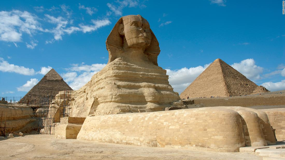 The Great Sphinx was carved from solid limestone in the 4th dynasty. With the body of a lion and the head of a man, Egyptologists Mark Lehner and Zahi Hawass believe it was the pharaoh Khafre who commissioned the monument. Unlike the sphinx of Greek antiquity, it does not feature a pair of wings.