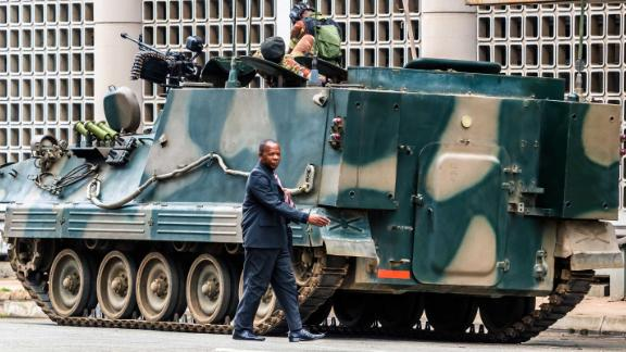 An armored vehicle is on patrol in Harare on November 16.