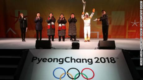 BUSAN, SOUTH KOREA - NOVEMBER 04:  Torch bearer Yang Jung-Mo holds the PyeongChang 2018 Winter Olympics torch during the PyeongChang 2018 Winter Olympic Games torch relay on November 4, 2017 in Busan, South Korea.  (Photo by Chung Sung-Jun/Getty Images)