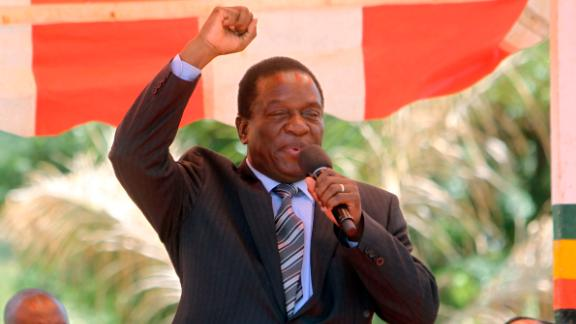 FILE -- In this Wednesday Feb. 10, 2016 file photo, Zimbabwean Deputy President Emmerson Mnangagwa greets party supporters at the ZANU-PF headquarters in Harare. Zimbabwean President Robert Mugabe on Monday, Nov. 6 2017 fired a vice president who had previously been seen as a likely successor, removing an obstacle to the presidential ambitions of Mugabe
