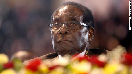 FILE - In this April 7,  2016 file photo Zimbabwean President Robert Mugabe attends a meeting with the country's war veterans in Harare.  Mugabe seemed almost untouchable for much of his nearly four-decade rule. Shrewd and ruthless, he managed to stay in power despite advancing age, growing opposition, international sanctions and the dissolving economy of a once-prosperous African nation. Now, the apparent abrupt end of the Mugabe era is launching Zimbabwe into the unknown. It's a humbling close to the career of a man who crushed dissent or sidelined opponents after leading Zimbabwe since 1980. (AP Photo/Tsvangirayi Mukwazhi, File)