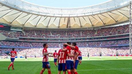 Atletico Madrid celebrates after scoring the opener in the 2-0 win over Sevilla, one of only two home victories this season.