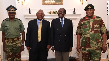 "This screengrab from Zimbabwe Broadcasting Corporation (ZBC) taken on November 16, 2017, shows Zimbabwe President Robert Mugabe (2R) as he poses alongside Zimbabwe Defence Forces Commander General Constantino Chiwenga (R) and South African envoys at State House in Harare.  Zimbabweans face an uncertain future without President Robert Mugabe after the army took power and placed the 93-year-old liberation hero turned authoritarian leader under house arrest. / AFP PHOTO / ZBC / - / RESTRICTED TO EDITORIAL USE - MANDATORY CREDIT ""AFP PHOTO / ZBC"" - NO MARKETING NO ADVERTISING CAMPAIGNS - DISTRIBUTED AS A SERVICE TO CLIENTS- NO RESALE   -/AFP/Getty Image"