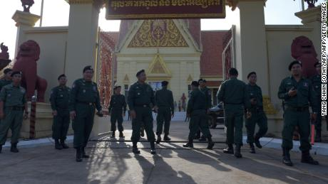 Cambodian police officials stand guard during a hearing in front of the Supreme Court building in Phnom Penh on November 16, 2017.
