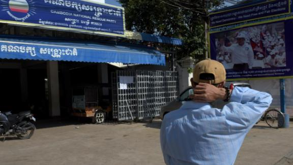 A man walks past the opposition Cambodia National Rescue Party (CNRP) headquarters in Phnom Penh on  Thursday.