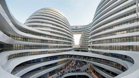 A modern Beijing landmark, Galaxy SOHO offers another example of Hadid's signature curves. They flow down from the building's four towers to a subterranean courtyard that was inspired by traditional Chinese architecture.