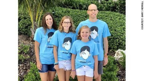 Emily Merrill, 13, with her parents, Nancy and Gary, and her sister, Abigail.