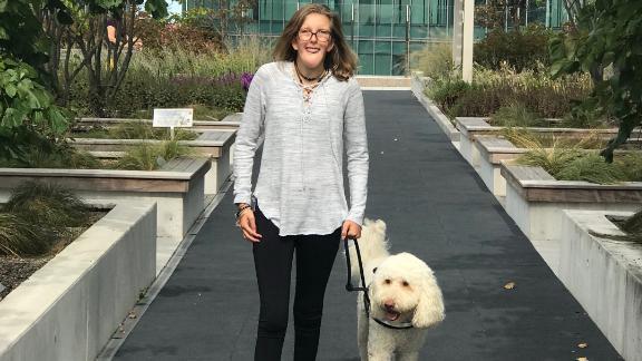 Emily Merrill, 13, with her service dog, Hank, outside Children's Hospital of Philadelphia.