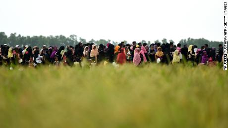 Rohingya Muslim refugees wait for relief aid at Nayapara refugee camp in Teknaf on October 21, 2017.