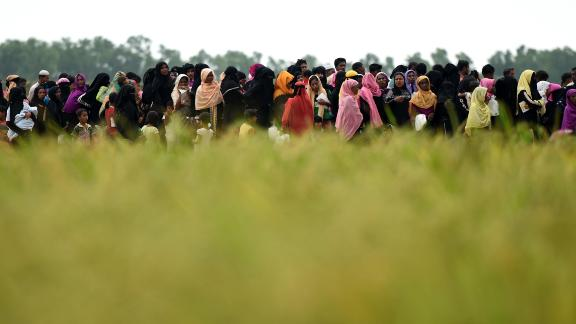 Rohingya refugees wait for relief aid at Nayapara camp in Teknaf near the Bangladesh-Myanmar border on October 21.