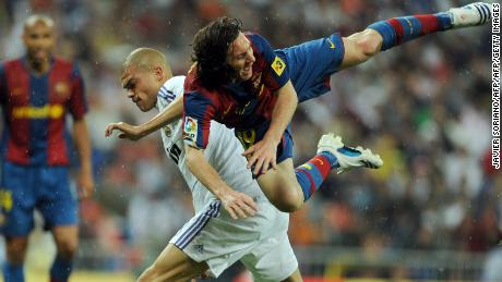 The ever combative Pepe vies with Lionel Messi.