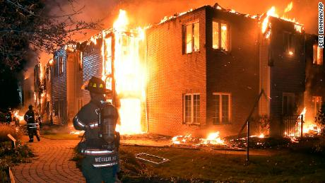 Firefighters battle a blaze at the Barclay Friends Senior Living Community in West Chester, Pa., Thursday, Nov. 16, 2017. Chester County emergency officials say at least 20 people have been taken to area hospitals for treatment. The extent of their injuries was not immediately known. (Pete Bannan/Daily Local News via AP)