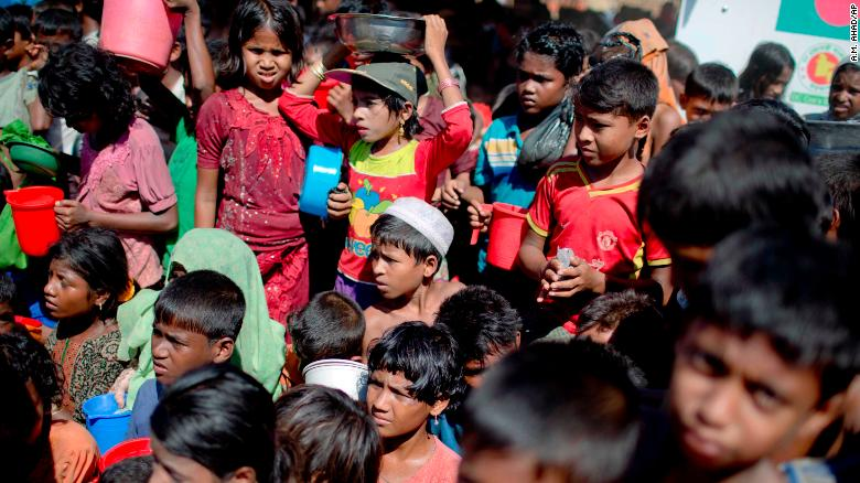 Rohingya children wait to receive food from an aid group at a refugee camp in Ukhiya, Bangladesh, on Tuesday, November 14. More than 600,000 of the Rohingya Muslim minority group from Myanmar's Rakhine state have fled to Bangladesh, according to the United Nations.