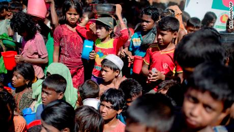 Rohingya Muslim children, who crossed over from Myanmar into Bangladesh, wait squashed against each other to receive food handouts distributed to children and women by a Turkish aid agency at the Thaingkhali refugee camp in Ukhiya, Bangladesh, Tuesday, Nov. 14, 2017. U.N. Secretary-General Antonio Guterres expressed alarm over the plight of Rohingya Muslims in remarks before Myanmar's Aung San Suu Kyi and other leaders from a Southeast Asian bloc that has refused to criticize her government over the crisis.(AP Photo/A.M. Ahad)