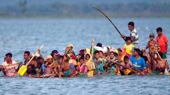Rohingya Muslims paddle a makeshift raft as they cross the Naf River from Myanmar into Bangladesh on November 12. Human rights activists consider the Rohingya to be among the world's most persecuted people.