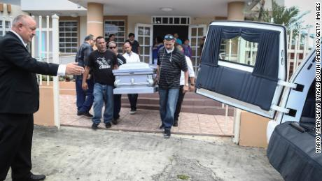 Mourners carry Sonia Irizarry's casket in October in Hormigueros. The hurricane delayed her funeral.