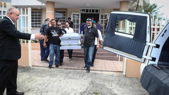 Mourners carry Sonia Irizarry's casket in October in Hormigueros. The hurricane delayed her funeral.
