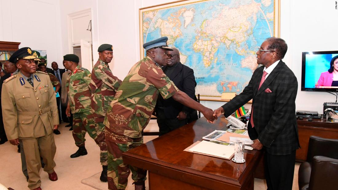 Mugabe meets with generals in Harare on November 19.