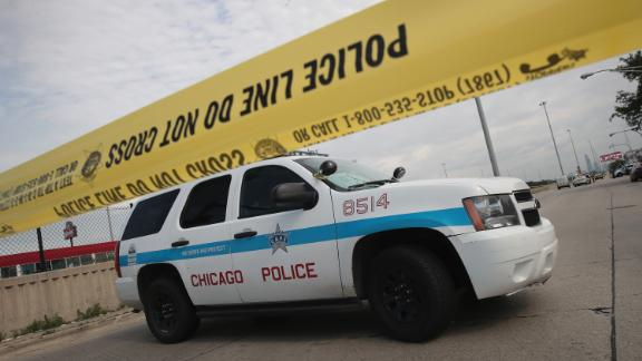 CHICAGO, IL - JUNE 30:  Police investigate the murder of a young man found shot to death in the back seat of a bullet-riddled car on June 30, 2017 in Chicago, Illinois. More than 300 people have been killed and more than 1700 wounded by gunfire in Chicago this year. On June 1, a task force was formed by the Chicago police, Illinois state police and the ATF to combat the gun violence in the city. ATF has formed similar task forces on a temporary basis to fight regional spikes in gun violence. Chicago