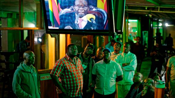 Zimbabweans watch Mugabe