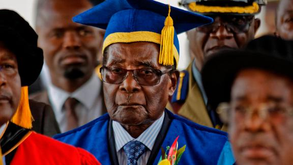 Mugabe, center, presides over a student graduation ceremony at Zimbabwe Open University on Friday.
