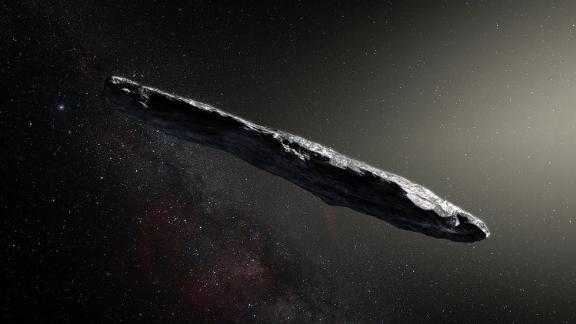 A photo illustration shows the first interstellar asteroid: `Oumuamua. This unique object was discovered on 19 October 2017 by the Pan-STARRS 1 telescope in Hawai`i. Subsequent observations from ESO's Very Large Telescope in Chile and other observatories around the world show that it was travelling through space for millions of years before its chance encounter with our star system. `Oumuamua seems to be a dark red highly-elongated metallic or rocky object, about 400 metres long, and is unlike anything normally found in the Solar System.