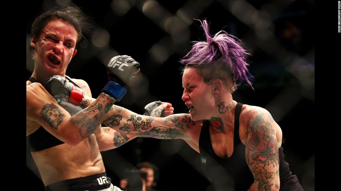 Bec Rawlings punches Jessica-Rose Clark during their UFC bout in Sydney on Sunday, November 19. Clark won by split decision.