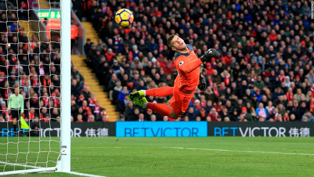 Southampton goalkeeper Fraser Forster watches the ball go into his net during a Premier League match in Liverpool, England, on Saturday, November 18. Liverpool defeated Southampton 3-0.